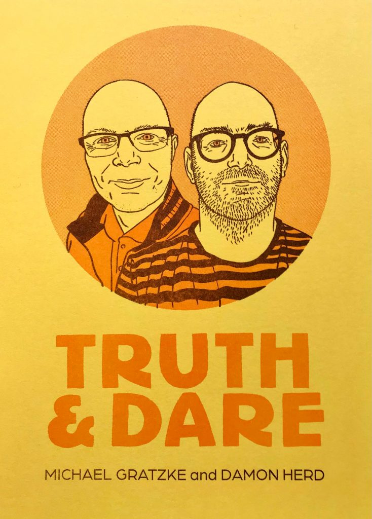 Front cover of Truth and Dare zine with drawing of two bald men wearing glasses