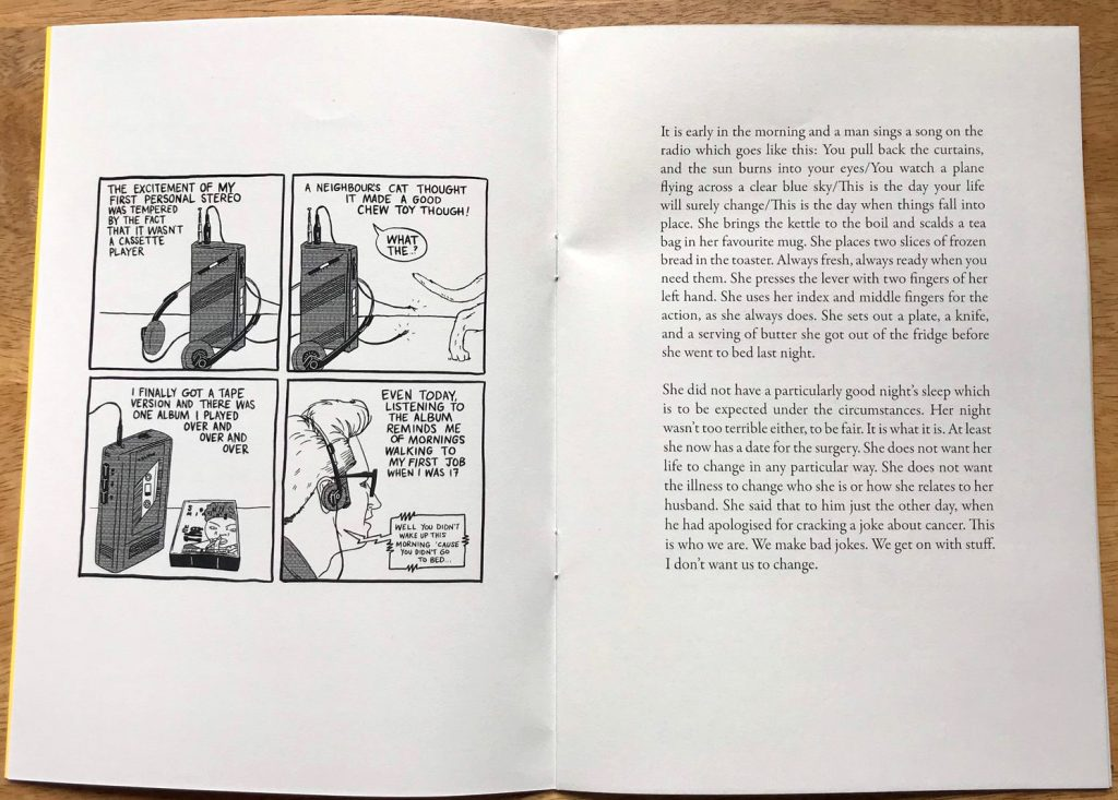 photograph of interior spread of zine with a comics strip on the left page and text on the right